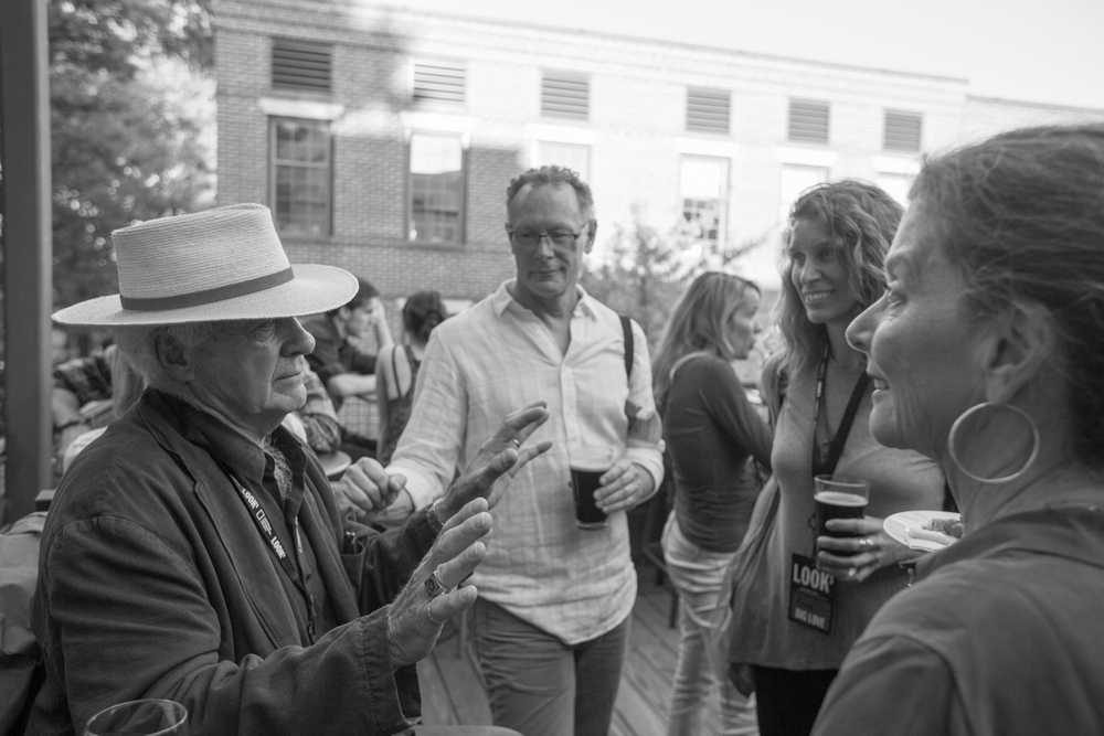 Bill Allard converses with festival attendees during the LOOK3 Toast the Artist reception for Frans Lanting and Christopher Morris.  Photo © Mina Von Feilitzsch