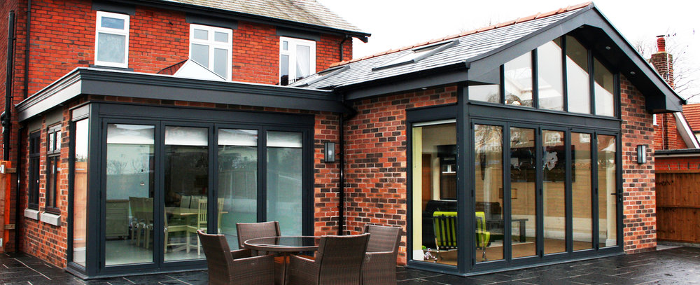 Southport Road, Lydiate - A contemporary rear extension and  modernisation project of a property in Lydiate. The scheme creates a new open plan Kitchen/Lounge/Dining space with feature apex glazing ,roof lanterns and velux rooflights