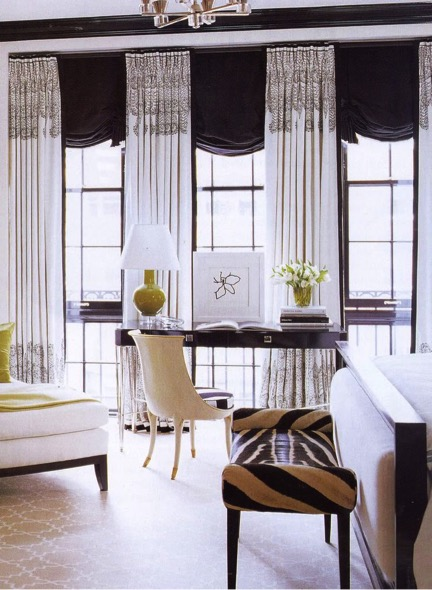 Black roman shades. Black and white embroidered draperies. Zebra hide bench. It takes traditional shapes and concepts, and tweaks them in a modern and fresh way. Love.