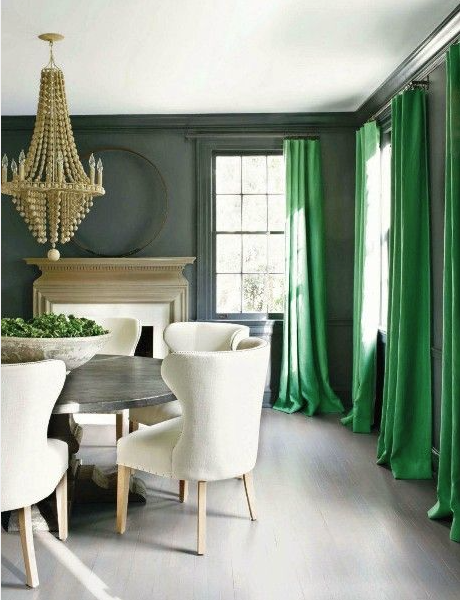 I love how the simple application of long, linen emerald draperies brings life to this room. It plays off of the earthier tone on the walls.