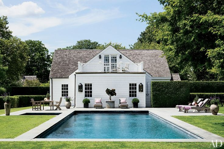 A classic Hamptons home is the perfect visual to start us off! I find myself drawing inspiration from the Hamptons quite frequently. Love this pool with coping that meets the grass. This clever installation of concrete pads for the furniture allows for easier maintenance and a very structured looking pool deck. .