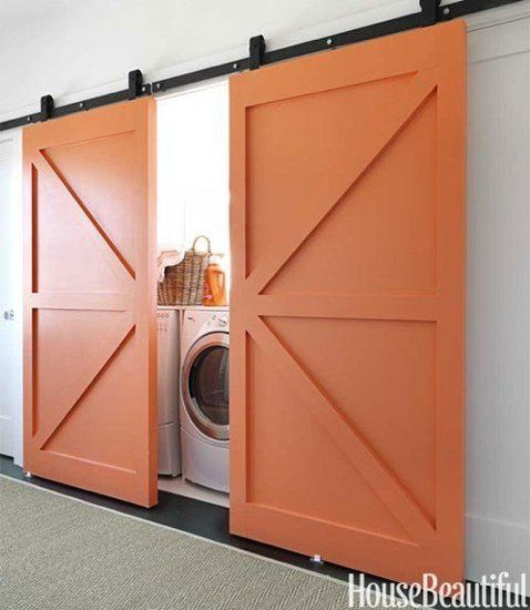 Always a fan of barn doors. These really make a statement when they are painted orange against a white wall. Who knew a laundry nook could be so cute?