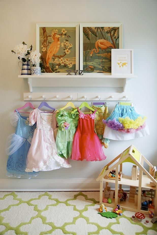 Such a simple idea here. Anyone can do this. Display play clothes on hooks to encourage cleaning up after play time is over!