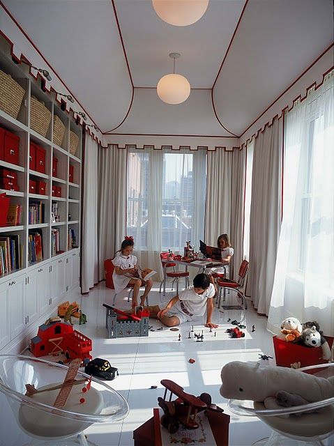 Circus tent inspired room. Love the idea of keeping the room open for play and storing books and toys in the cabinet. Notice the modern lights with the more traditional detailing on the white ceiling tent. What a functional yet whimsical look. Oh, and look... all of the kids are dressed in white. ;)