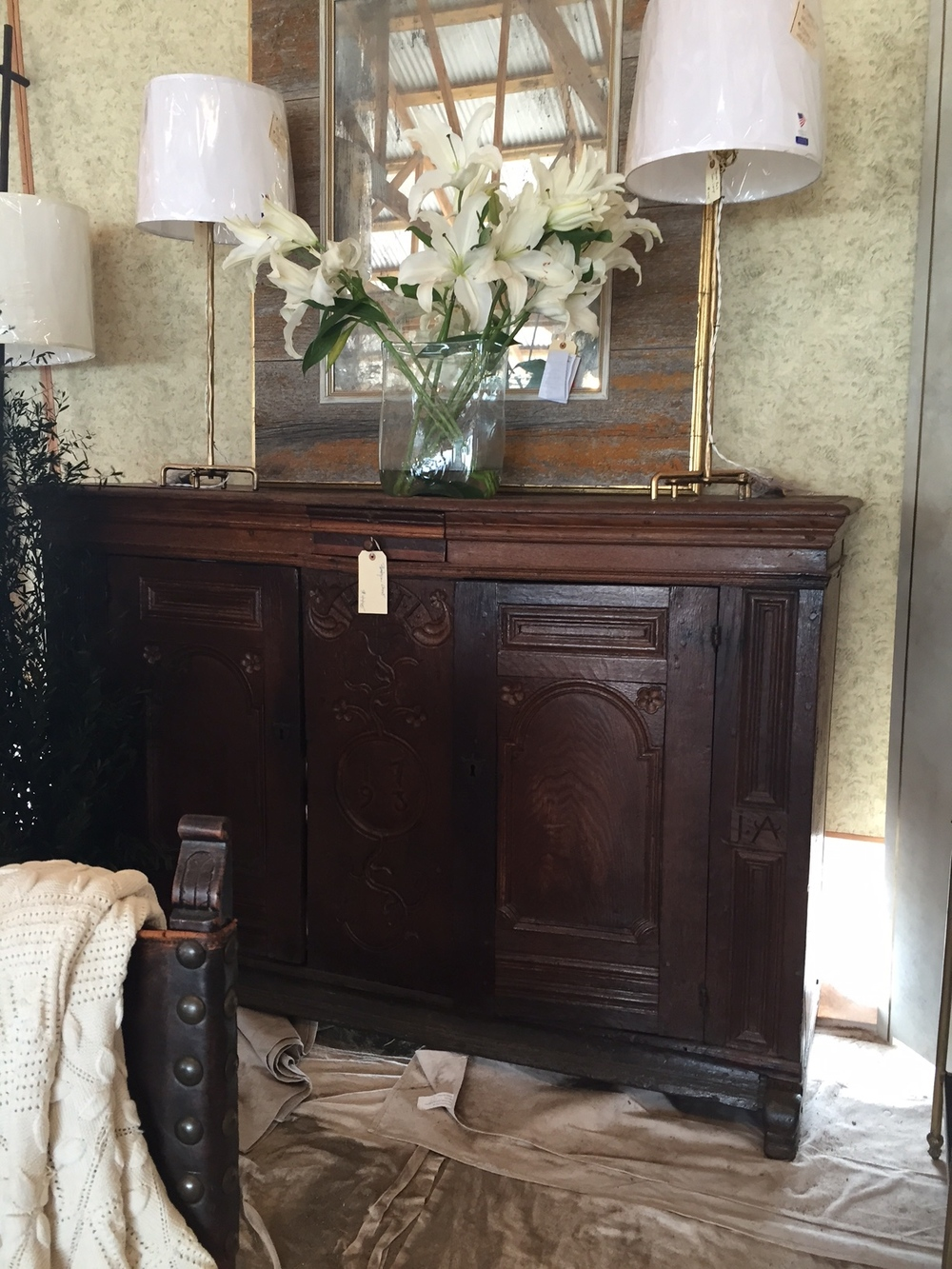 Petite antique lamps flanking a beautiful distressed mirror. Gorgeous chest dating from 1793.