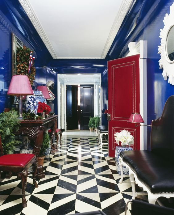Take colors that do not usually complement each other and make them work together to create striking contrast. Look at that floor! The black and white provides great contrast for the red door.