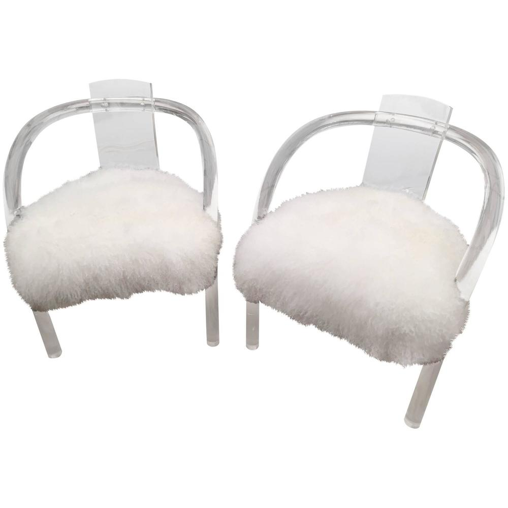Antique Hollis Jones chairs covered in white Tibetan fur. Contrasting the modernist look with overwhelming texture.  This pair available at Shop Tiffany.