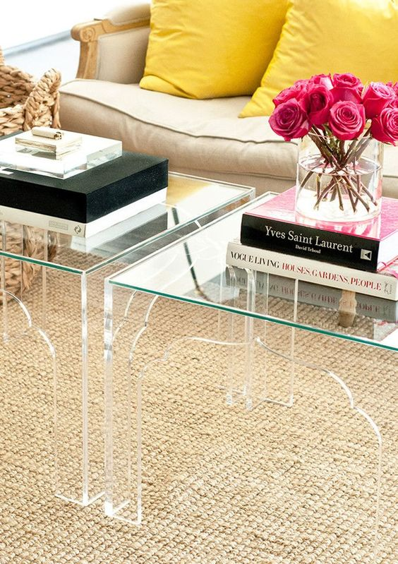 Lucite tables in a traditional form. Love the layering of textures here.