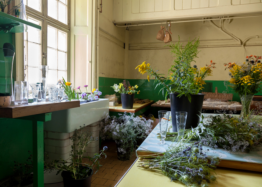 Flower arranging in the scullery, Tyntesfield House