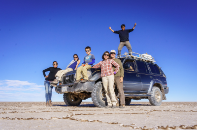 Our favorite place on our RTW trip so far is Salar de Uyuni in Bolivia. Here we are with our guide and driver.