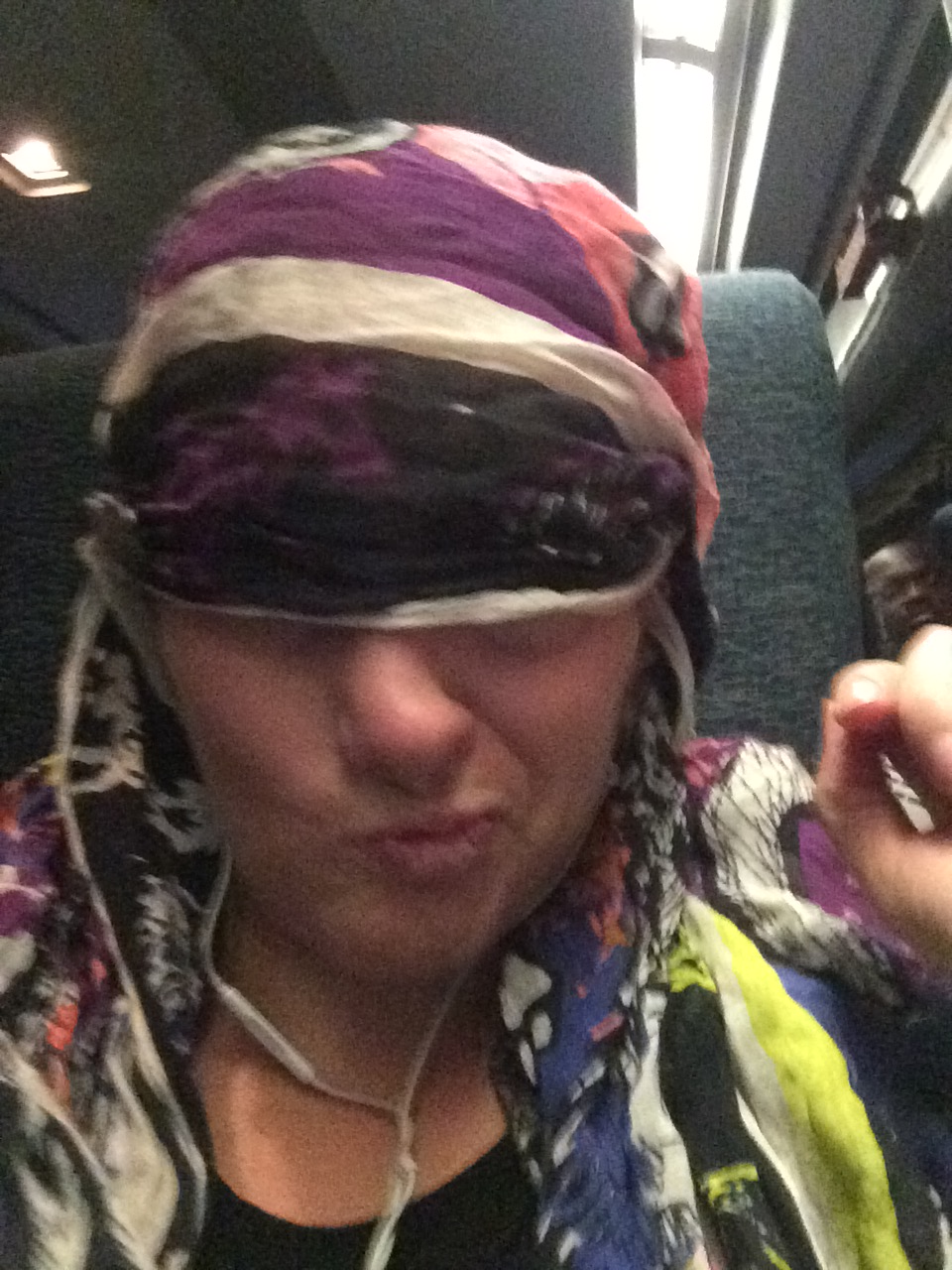 My makeshift eye mask on the train. I am a very cute traveler.