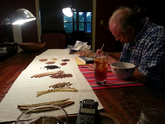 Heirloom seed saver John Coykendall at my kitchen table, sharing his knowledge of seed saving with us. He is here writing down histories, stories, and names of some of his collection of filed peas.