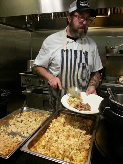 Chef Travis Milton dishing out the best mac and cheese I have ever known.