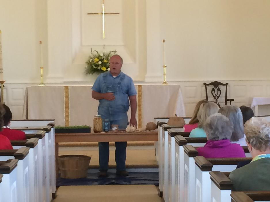 Evangelical seed saver John Coykendall is pictured here holding court in the Church house during 2015 Garden Day at Saint Andrew's Episcopal Church, Maryville, Tennessee.
