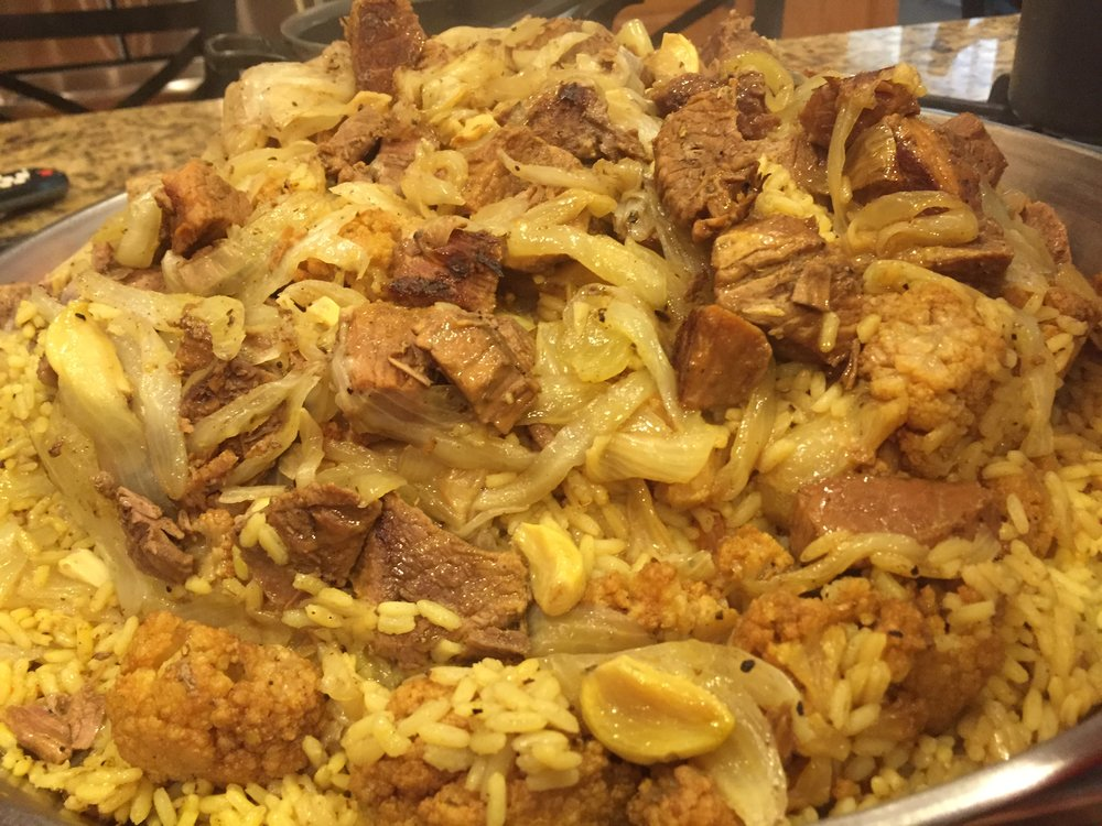 "Pictured is Rita's ""Maqluba dish"" made of upside-down eggplant, rice, lamb & cauliflower casserole dish."