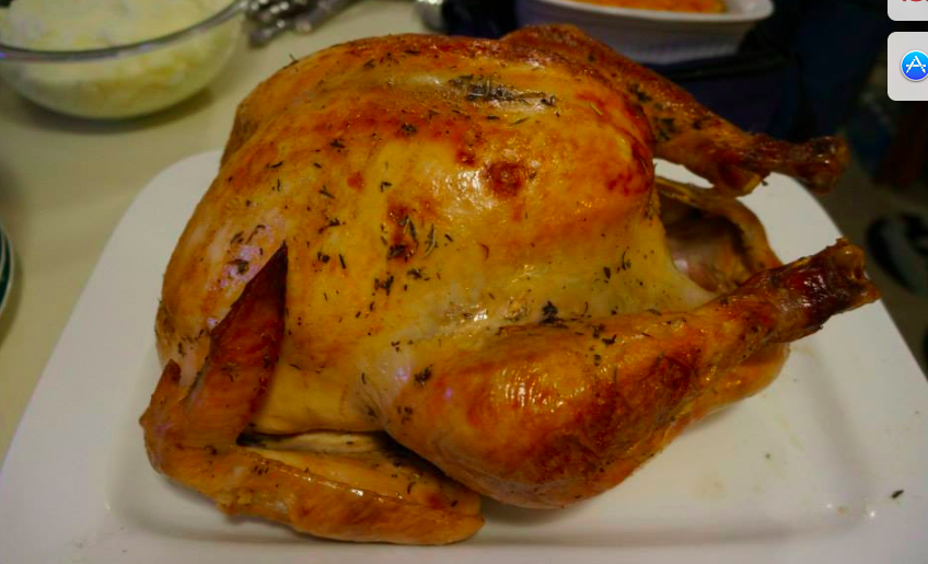 "A picture of Rachel McCormick's ""Always juicy, brined turkey"" recipe is written below."
