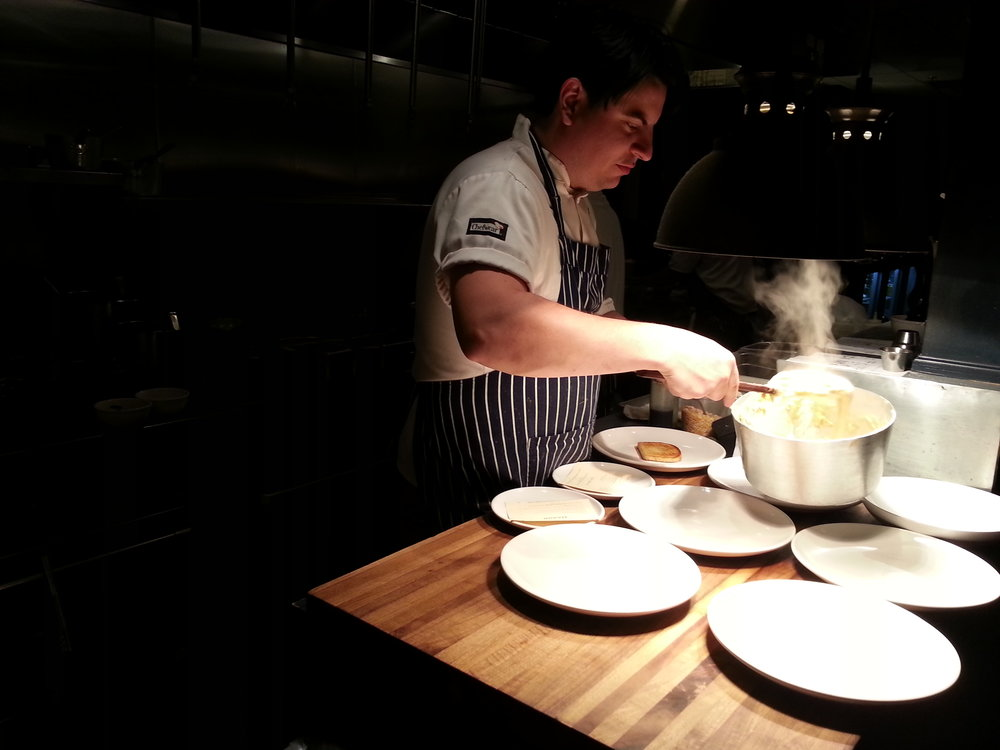 Matt Gallaher ladles out something delicious at his  Knox Mason restaurant . Photo, Amy Campbell.
