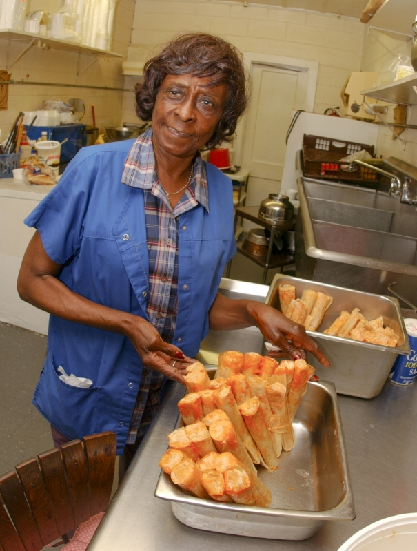 "This is a picture of Clara Robinson by way of Fred Sauceman. Fred shares a food history memory of the 20 years that Clara Robinson made and sold Hot Tamales on Magnolia, Avenue in Knoxville, TN on this podcast from his ""Pot Luck Radio"" segment."