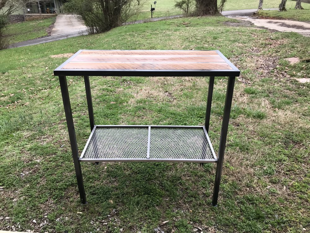 Kitchen table made by Clint Smith from barn wood and welded steel.