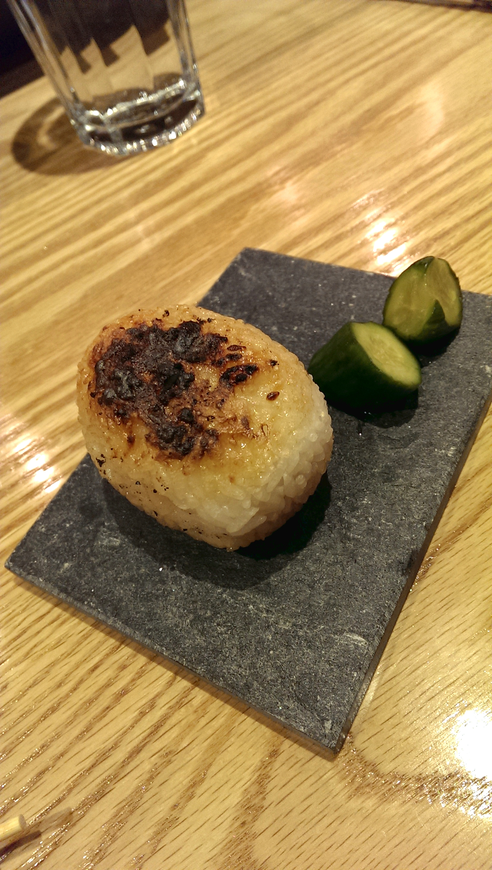 Yakionigiri (bincho charcoal grilled rice ball with a choice of plum or konbu kelp)