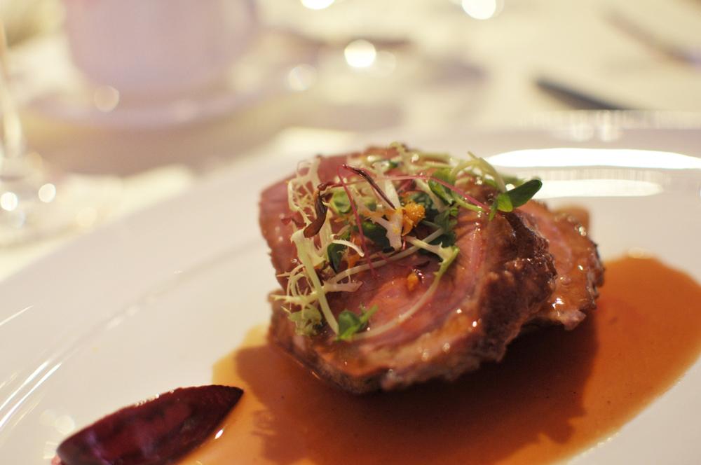 Seared duck breast with brioche pudding and orange essence