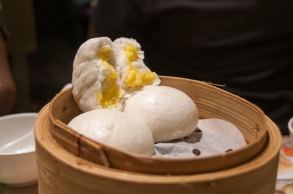 Steamed egg custard buns, delightfully sweet inside a fluffy bun