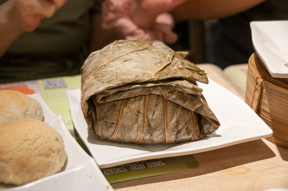 Glutinous rice dumpling (lor mei gai) - steamed chicken and shiitake mushrooms with sticky rice wrapped in a lotus leaf