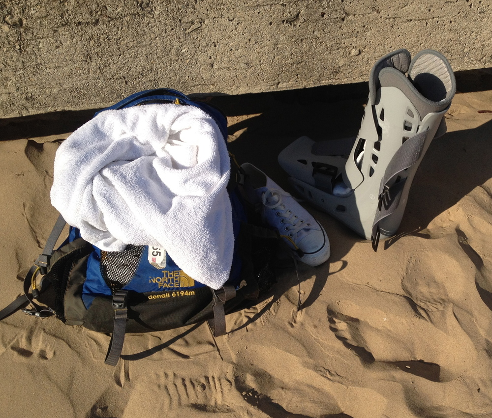 My boot sunbaths in the sand during a lake swim.