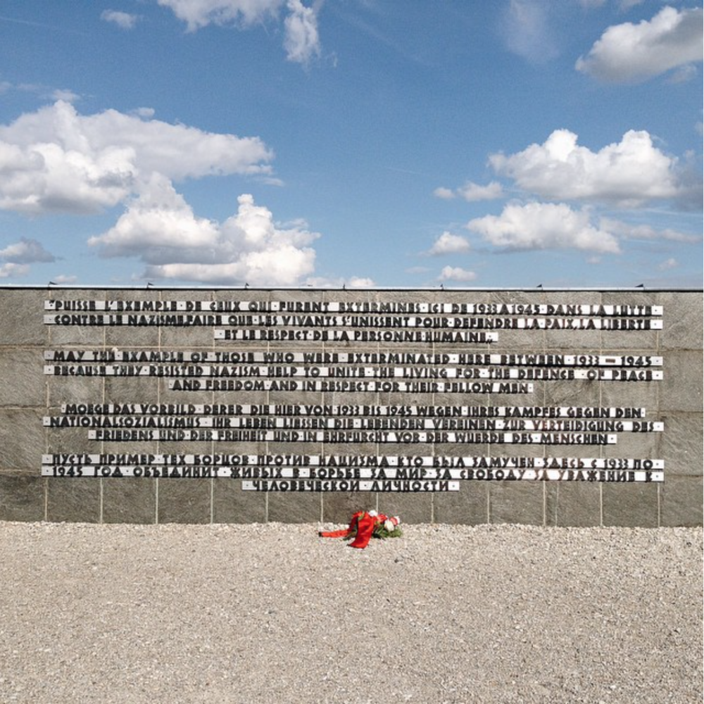 "This is a picture from a trip to Germany. It's the concentration camp in Dachau. I just wanted to share this moment and the potency of the words that were on that wall. They say:  ""May the example of those who were exterminated here between 1933 - 1545 because they resisted Nazism help to reunite the living for defense of peace and freedom and a respect for their fellow man."""