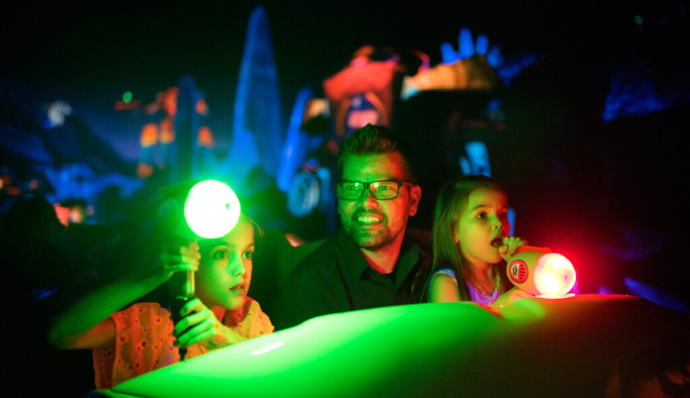 Drake rides Buzz Lightyear Planet Rescue with his two daughters - Photo Credit: Fortune