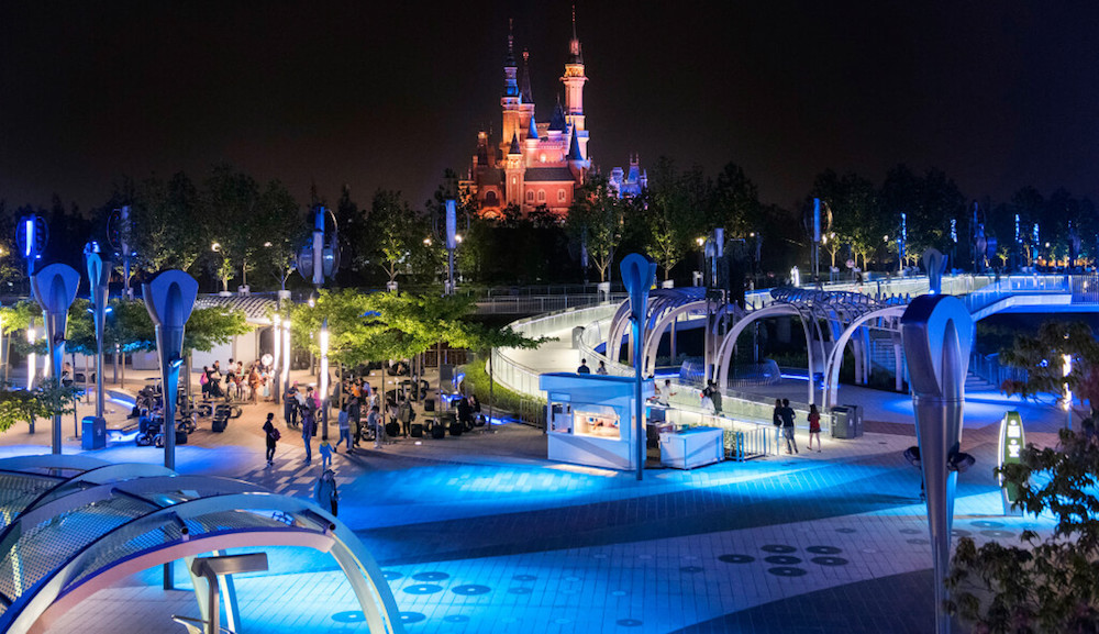 A view of Shanghai Disney's Tomorrowland in the foreground, with Fantasyland's Enchanted Storybook Castle, the world's tallest Disney castle, in the distance - Photo Credit: Fortune