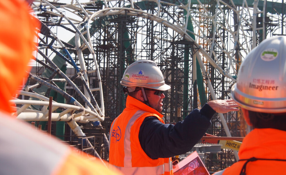 Drake leads one his many site walks to review construction progress on Tomorrowland in July 2015 - Photo Credit: Disney