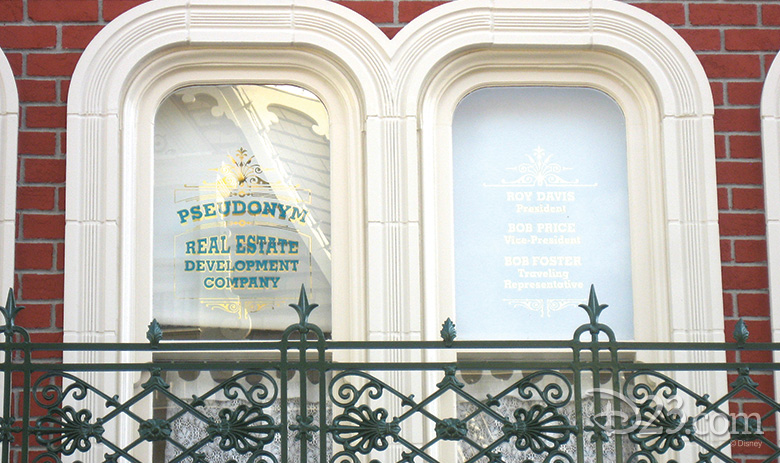 The Main Street, U.S.A. window representing the Pseudonym Real Estate Development Company with its phantom leaders, Roy Davis, Bob Price, and Bob Foster - Photo Credit: Disney