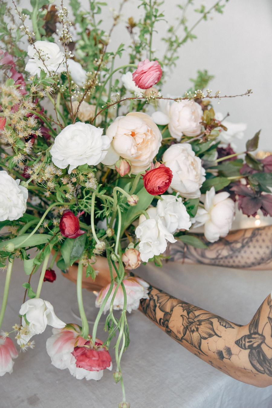The small bursts of reds, pinks and corals the ranunculi provide in this arrangement more life a joy to a rather traditional palette. See more from Nicole Land's Soil & Stem Spring Floral Design Workshop now featured on Cottage Hill.