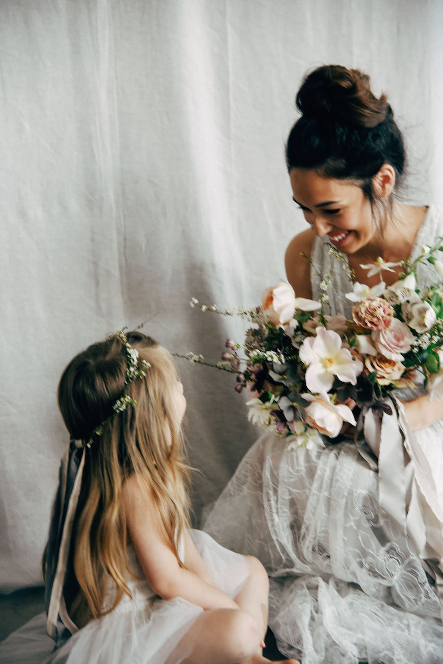 The most adorable flower girl and bride moment. Beautiful blooms by Soil & Stem, captured by Tess Comrie, now on Cottage Hill.