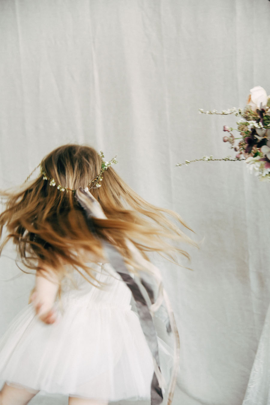 The most adorable flower girl twirls in Frou Frou Chic ribbons, Soil & Stem blooms and captured by Tess Comrie, see more on Cottage Hill