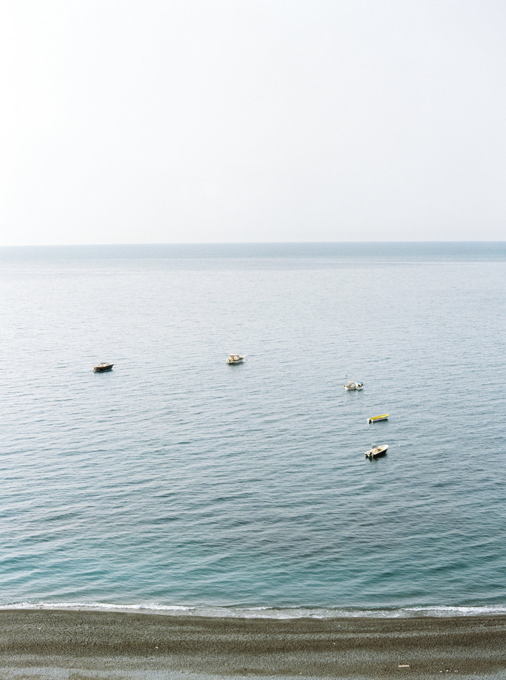 Boats off the Amalfi Coast, Positano to be exact. See more now on Cottage Hill