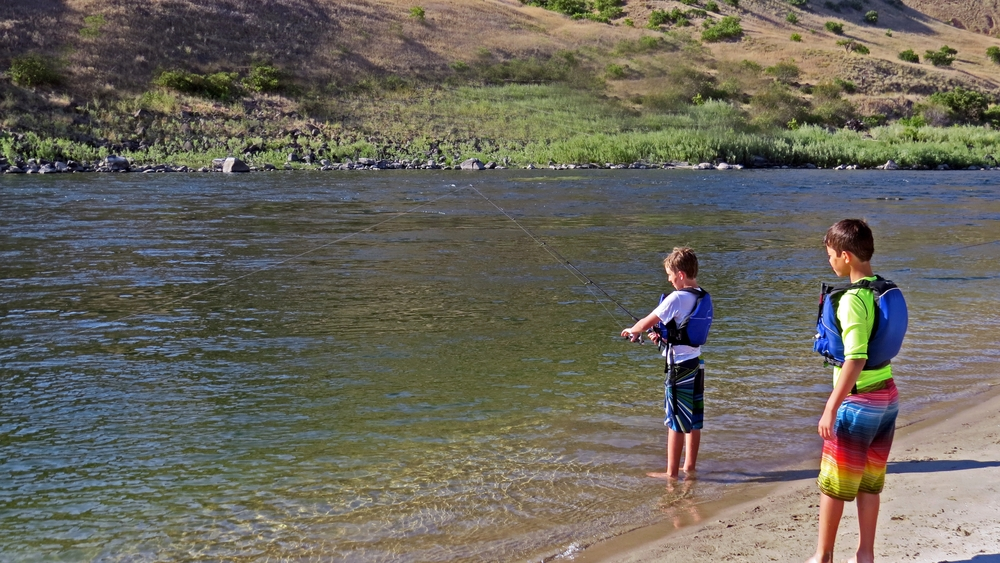 Kids fishing on a camping trip on the Salmon River
