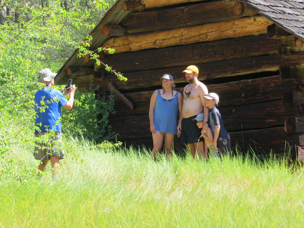 Family at historic cabin on Main Salmon River