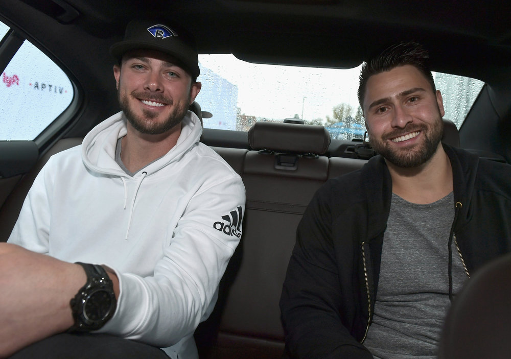 Major League Baseball players Kris Bryant and Joey Gallo ride in a Lyft and Aptiv self-driving car during CES 2018.