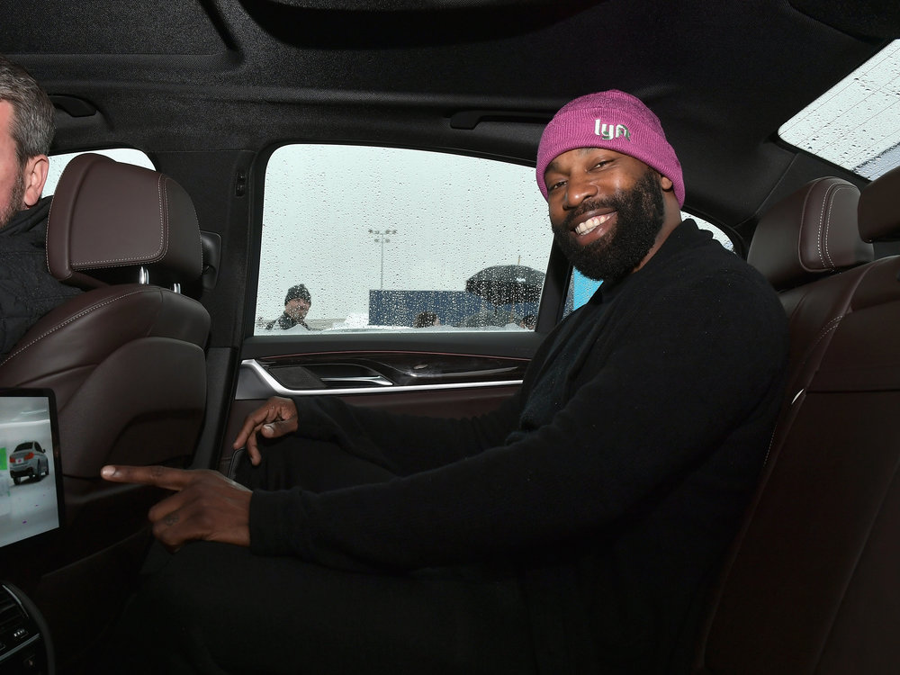 Former NBA player Baron Davis poses in a self-driving ride from Lyft and Aptiv.