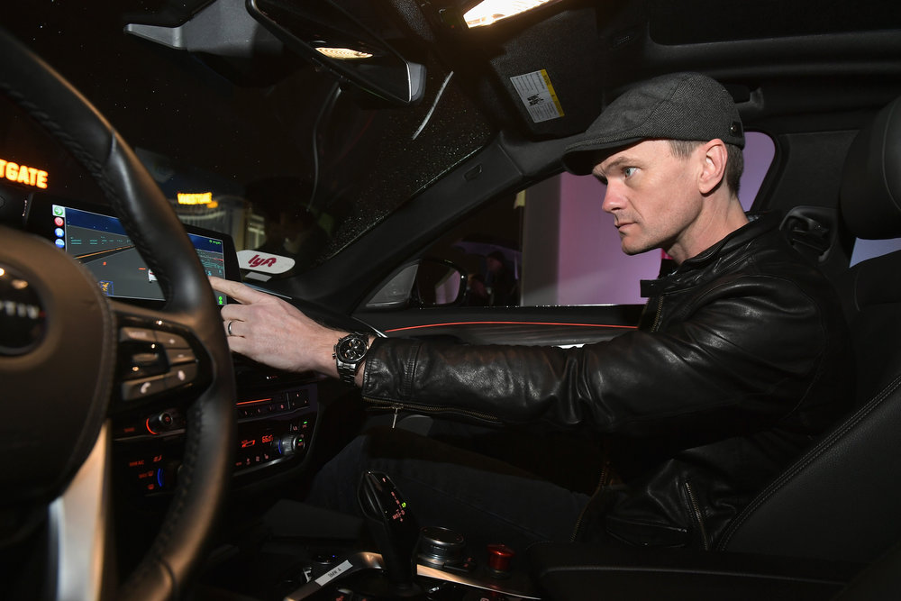 Actor Neil Patrick Harris rides in a Lyft and Aptiv self-driving car during CES 2018
