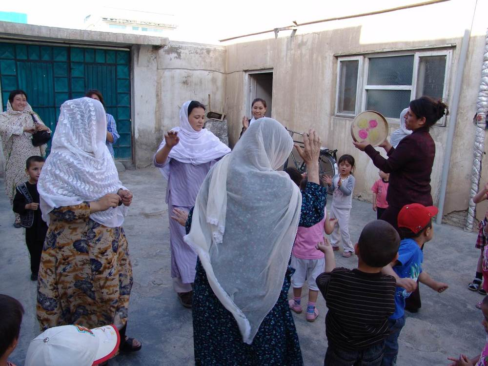 Mothers and children with teachers dancing at school.jpg