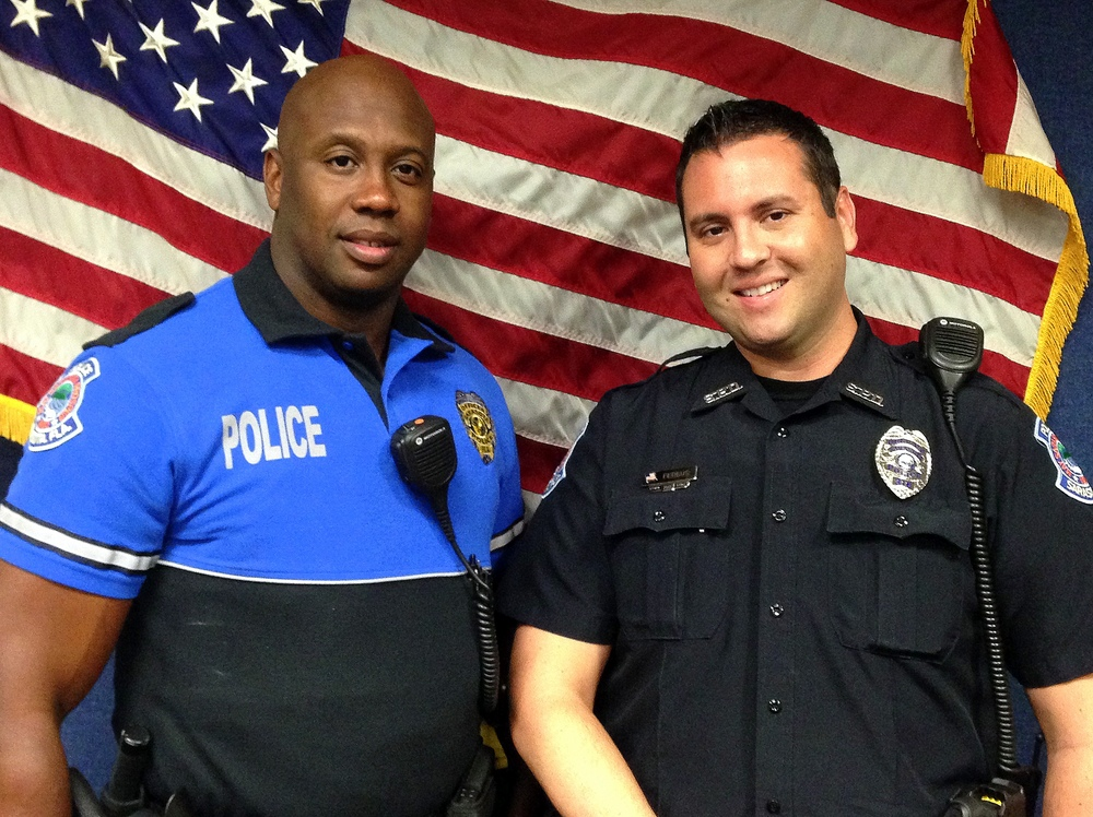 Officer Dominic Harris and Officer Steven Fergus worked together to save a baby choking on a chicken bone