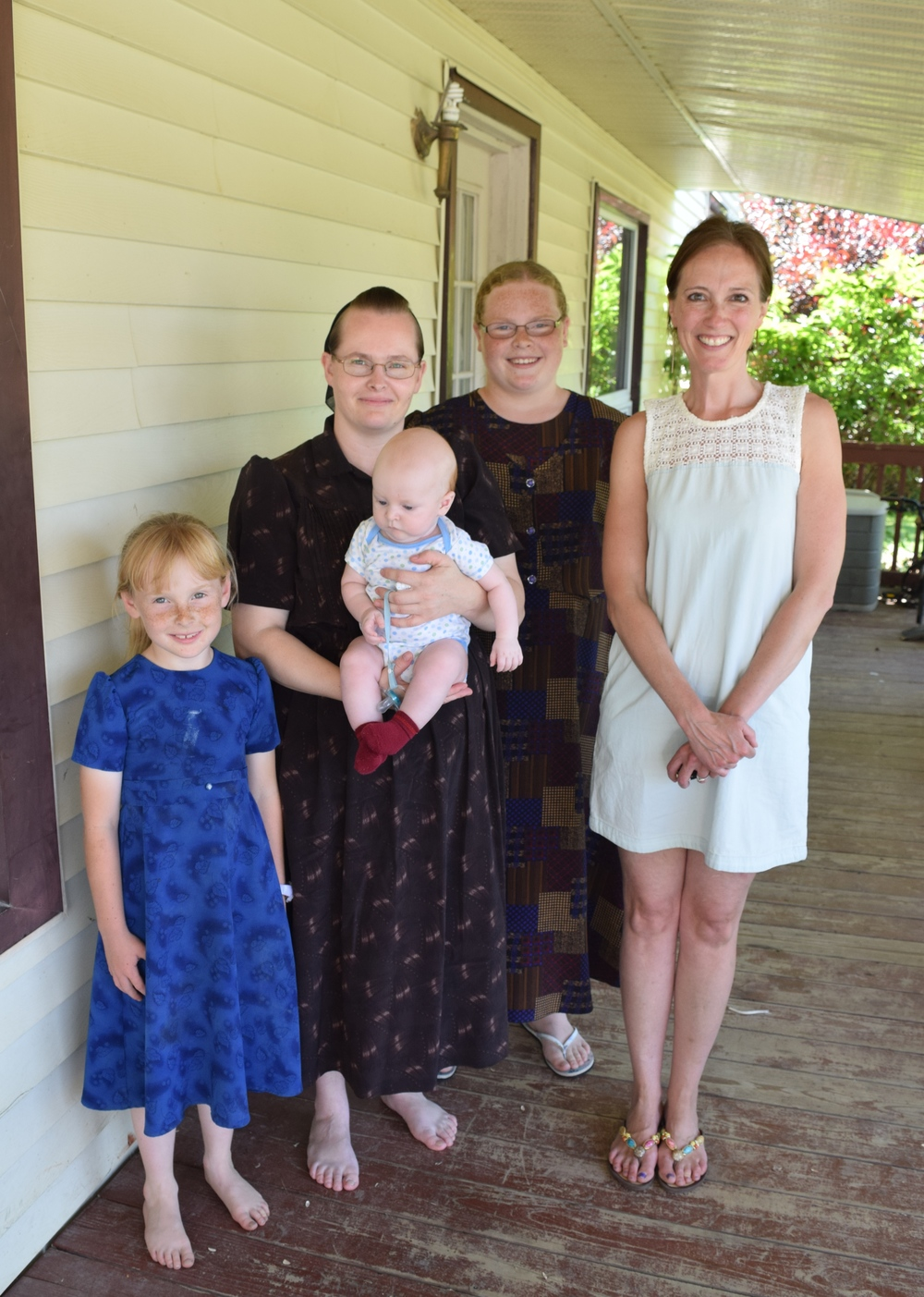 Alisa Murphy with a Low German speaking family in Aylmer, Ontario