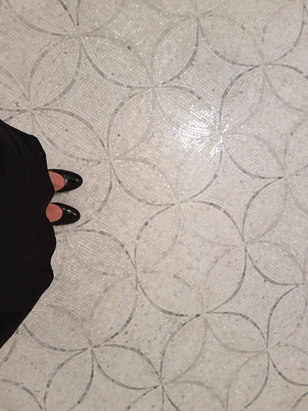 Tile floor in pool cabana.