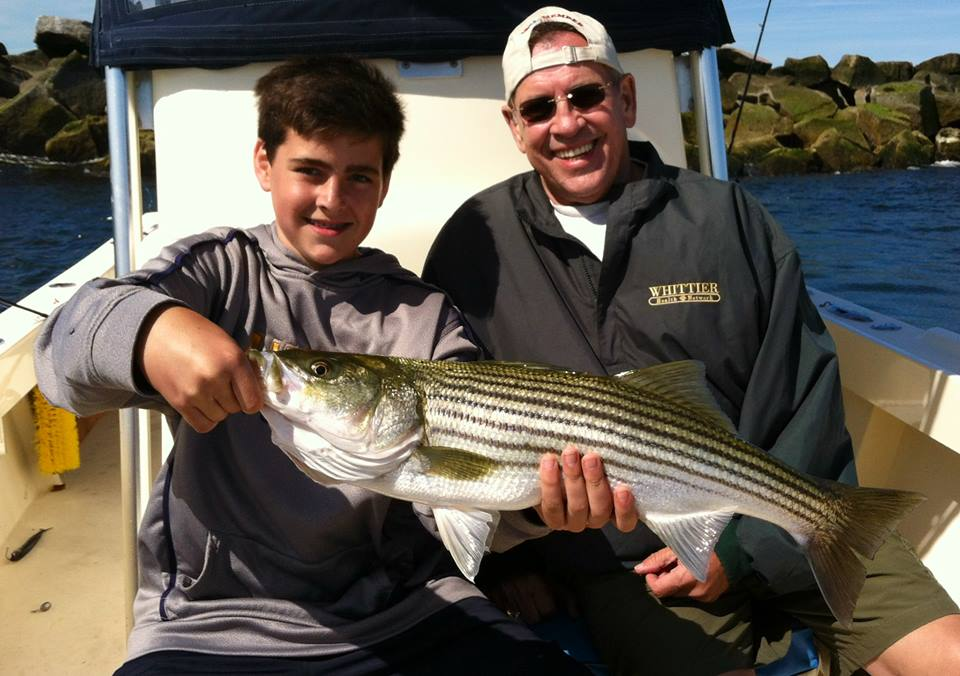 Matt and Grandfather Brian with their first ever striper! Caught while drift the mouth of the Merrimack River aboard Manolin Charters!