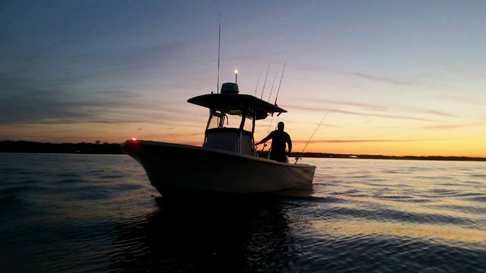 The Manolin and Capt. Chris drfiting pogies on Joppa Flats during an awesome Merrimack River sunset