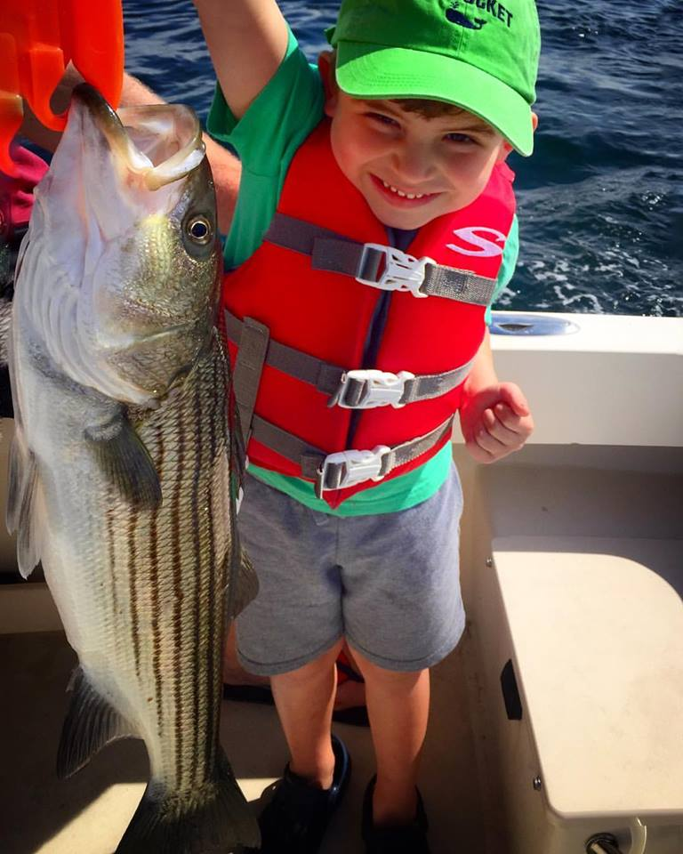 Grady, 4 years old, with his first fish ever on Manolin Charters!