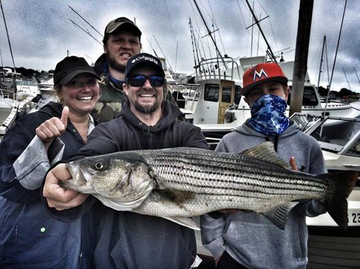 "Cheryl, Chris, and the boys battled some rough seas and early sloppy weather but managed to grab a nice 33"" to go along with a ton at 27"" just missing the cut."